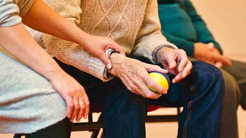 Long-Term Care Provider Assisting Patient