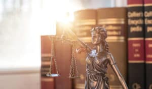Lady Justice guarding the books of law